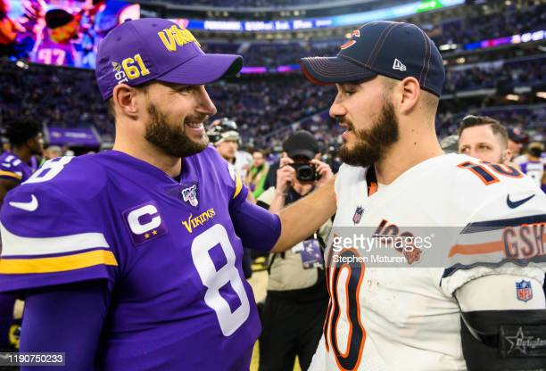 Mitchell Trubisky of the Chicago Bears greets Kirk Cousins of the Minnesota Vikings after the game at U.S. Bank Stadium on December 29, 2019 in...