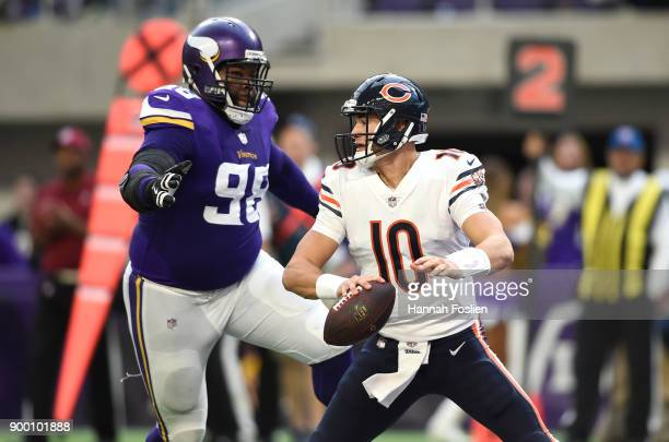 Mitchell Trubisky of the Chicago Bears is pursued by defender Linval Joseph of the Minnesota Vikings in the second quarter of the game on December 31...