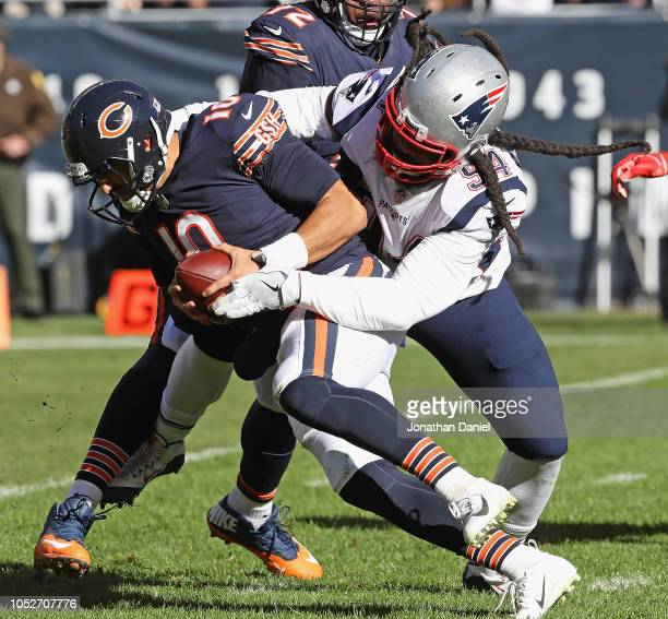 Mitchell Trubisky of the Chicago Bears is sacked by Adrian Clayborn of the New England Patriots at Soldier Field on October 21, 2018 in Chicago,...