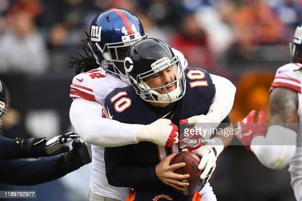 Mitchell Trubisky of the Chicago Bears is sacked by Markus Golden of the New York Giants during the first half at Soldier Field on November 24, 2019...