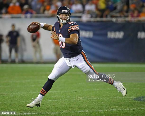 Mitchell Trubisky of the Chicago Bears looks for a receiver against the Denver Broncos during a preseason game at Soldier Field on August 10, 2017 in...