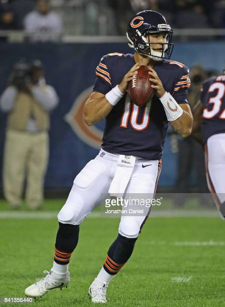 Mitchell Trubisky of the Chicago Bears looks for a receiver against the Cleveland Browns during a preseason game at Soldier Field on August 31 2017...