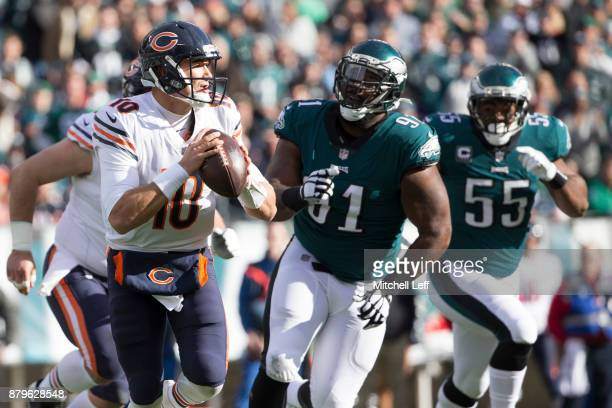 Mitchell Trubisky of the Chicago Bears looks to pass the ball against Fletcher Cox and Brandon Graham of the Philadelphia Eagles in the first quarter...