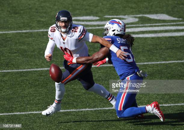 Mitchell Trubisky of the Chicago Bears loses the ball as he is hit by Julian Stanford of the Buffalo Bills during NFL game action at New Era Field on...