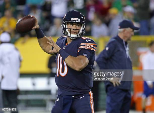 Mitchell Trubisky of the Chicago Bears participates in warmups as head coch John Fox watches before a game against the Green Bay Packers at Lambeau...