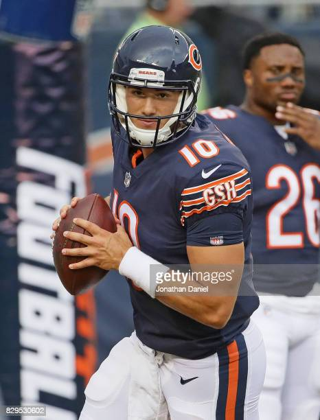 Mitchell Trubisky of the Chicago Bears participates in warmups before a game against the Denver Broncos at Soldier Field on August 10 2017 in Chicago...