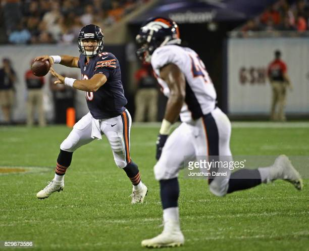 Mitchell Trubisky of the Chicago Bears passes as Quentin Gause of the Denver Broncos gives chase during a preseason game at Soldier Field on August...