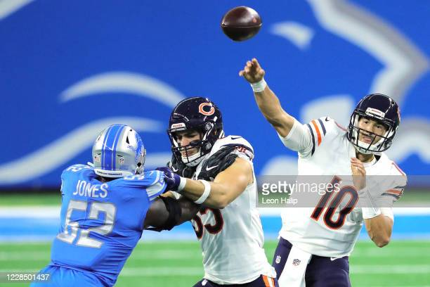 Mitchell Trubisky of the Chicago Bears passes the ball during the fourth quarter of the game against the Detroit Lions as Cole Kmet blocks Christian...