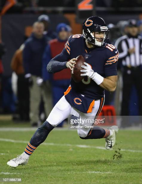 Mitchell Trubisky of the Chicago Bears rolls out to look for a receiver against the Los Angeles Rams at Soldier Field on December 9 2018 in Chicago...