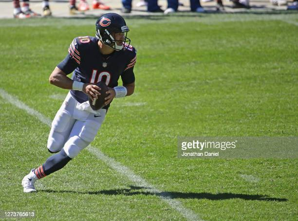 Mitchell Trubisky of the Chicago Bears rolls out to look for a receiver against the New York Gianst at Soldier Field on September 20 2020 in Chicago...