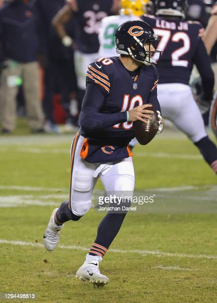 Mitchell Trubisky of the Chicago Bears rolls out to look for a receiver against the Green Bay Packers at Soldier Field on January 03, 2021 in...