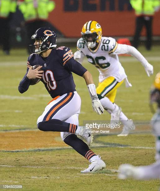 Mitchell Trubisky of the Chicago Bears runs against the Green Bay Packers at Soldier Field on January 03, 2021 in Chicago, Illinois. The Packers...