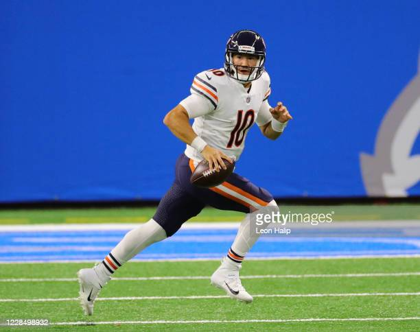 Mitchell Trubisky of the Chicago Bears runs for a first down during the fourth quarter of the game against the Detroit Lions at Ford Field on...