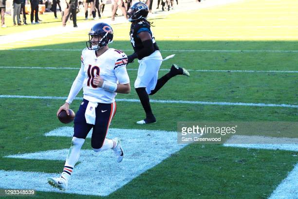 Mitchell Trubisky of the Chicago Bears scores a touchdown during the third quarter against the Jacksonville Jaguars at TIAA Bank Field on December...
