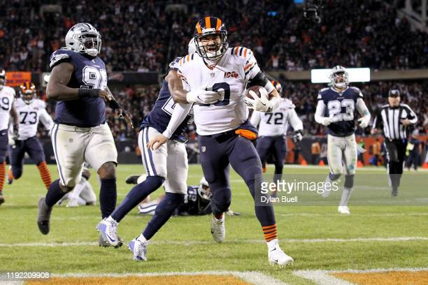 Mitchell Trubisky of the Chicago Bears scores a touchdown past Chidobe Awuzie of the Dallas Cowboys in the fourth quarter at Soldier Field on...