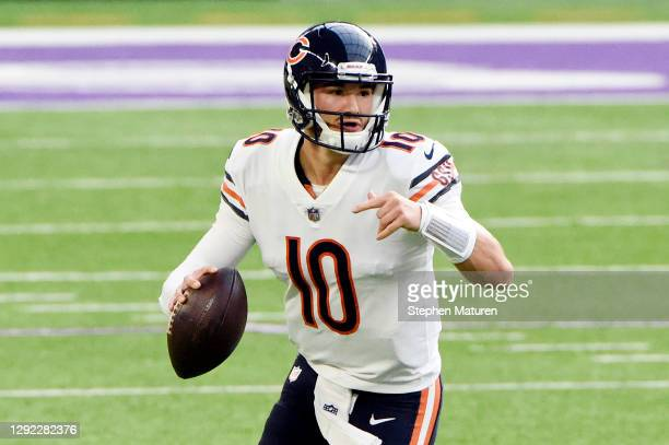 Mitchell Trubisky of the Chicago Bears scrambles with the ball during the first half against the Minnesota Vikings at U.S. Bank Stadium on December...