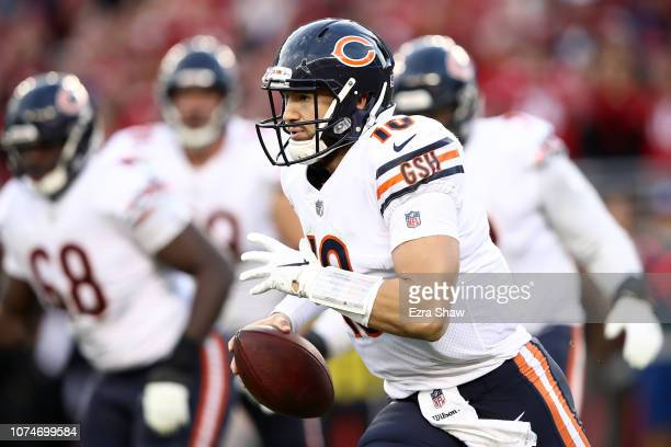 Mitchell Trubisky of the Chicago Bears scrambles with the ball against the San Francisco 49ers during their NFL game at Levi's Stadium on December 23...