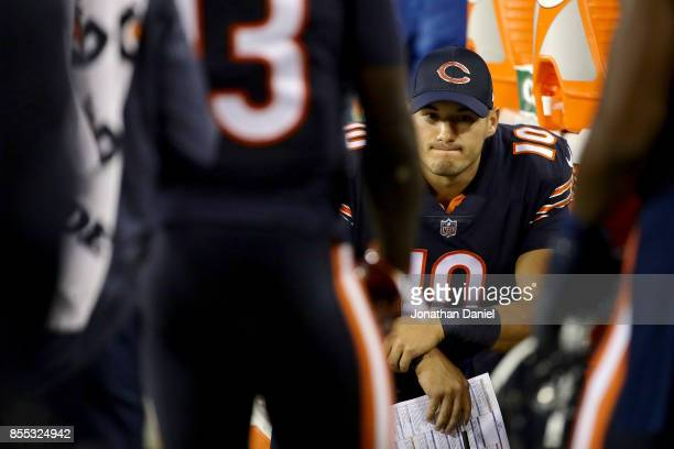 Mitchell Trubisky of the Chicago Bears sits on the sideline in the second quarter against the Green Bay Packers at Lambeau Field on September 28 2017...