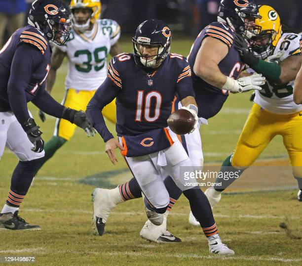 Mitchell Trubisky of the Chicago Bears turns to hand offsides against the Green Bay Packers at Soldier Field on January 03, 2021 in Chicago,...