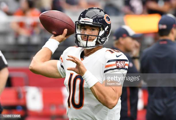 Mitchell Trubisky of the Chicago Bears avoids a tackle by Gerald Hodges of the Arizona Cardinals during the second half at State Farm Stadium on...