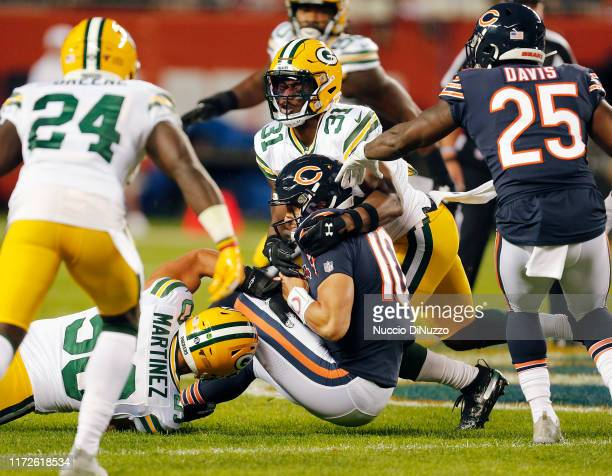 Mitchell Trubisky of the Chicago Bears was brought down by Blake Martinez and Adrian Amos of the Green Bay Packers during the first quarter of a game...