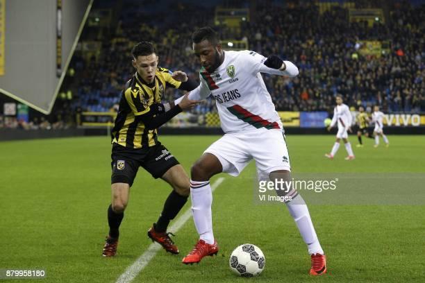 Mitchell van Bergen of Vitesse Wilfried Kanon of ADO Den Haag during the Dutch Eredivisie match between Vitesse Arnhem and ADO Den Haag at Gelredome...