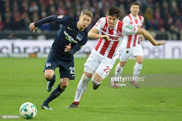 Mitchell Weiser Jorge Mere of Koeln battle for the ball during the Bundesliga match between 1 FC Koeln and Hertha BSC at RheinEnergieStadion on...