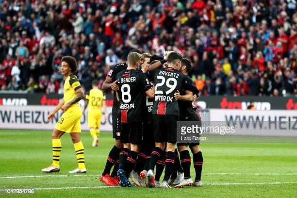 Mitchell Weiser of Bayer 04 Leverkusen celebrates with teammates after scoring his team's first goal during the Bundesliga match between Bayer 04...