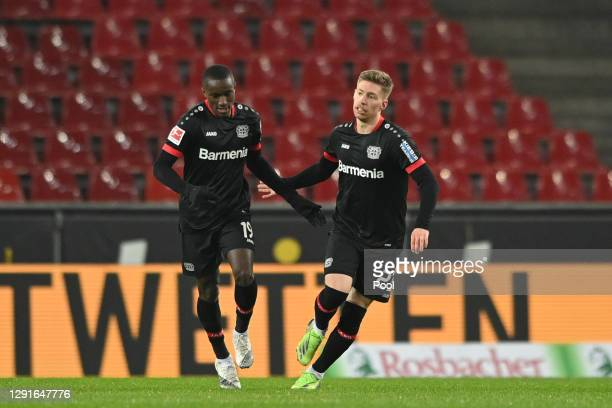 Mitchell Weiser of Bayer Leverkusen celebrates after scoring their team's first goal with teammate Moussa Diaby during the Bundesliga match between...