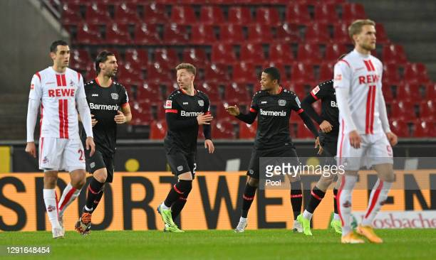 Mitchell Weiser of Bayer Leverkusen celebrates after scoring their team's first goal during the Bundesliga match between 1. FC Koeln and Bayer 04...