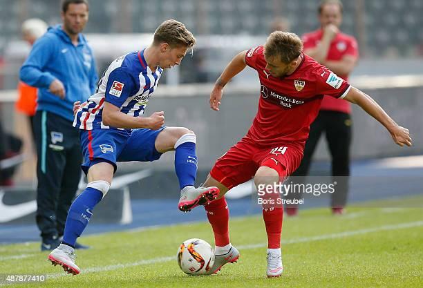 Mitchell Weiser of Berlin is challenged by Alexandru Iulian Maxim of Stuttgart during the Bundesliga match between Hertha BSC and Vfb Stuttgart at...