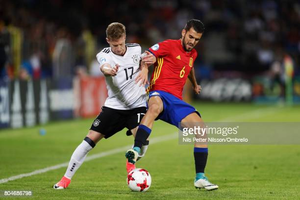 Mitchell Weiser of Germany and Dani Ceballos of Spain competes for the ball during the UEFA U21 Final match between Germany and Spain at Krakow...