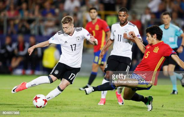 Mitchell Weiser of Germany and Jesús Vallejo of Spain during the UEFA U21 Final match between Germany and Spain at Krakow Stadium on June 30, 2017 in...