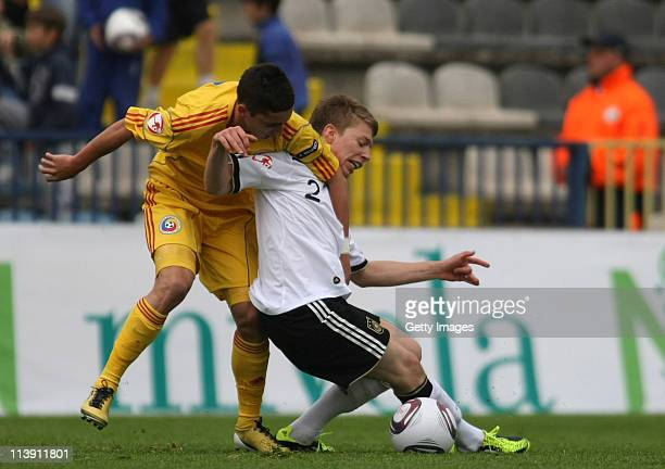 Mitchell Weiser of Germany battles for the ball with Steliano Filip of Romania during the UEFA European U17 Championship final round match between...