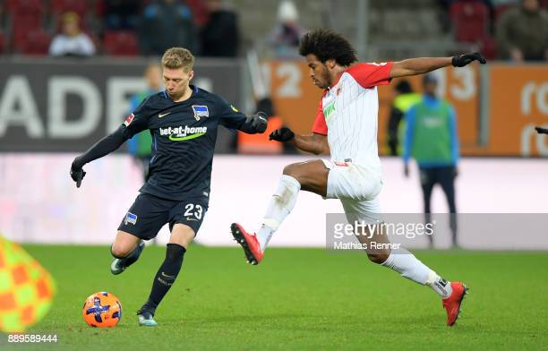 Mitchell Weiser of Hertha BSC and Caiuby of FC Augsburg during the game between dem FC Augsburg and Hertha BSC on december 10 2017 in Augsburg Germany