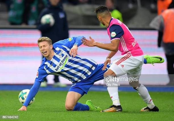 Mitchell Weiser of Hertha BSC and Douglas dos Santons Justino del Melo of Hamburger SV during the game between Hertha BSC and Hamburger SV on October...