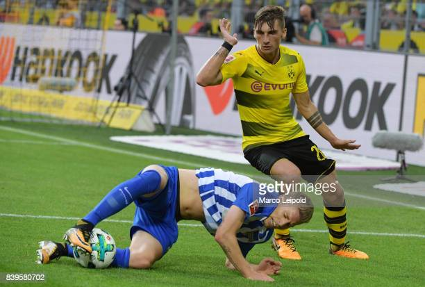 Mitchell Weiser of Hertha BSC and Maximilian Philipp of Borussia Dortmund during the game between Borussia Dortmund and Hertha BSC on august 26 2017...