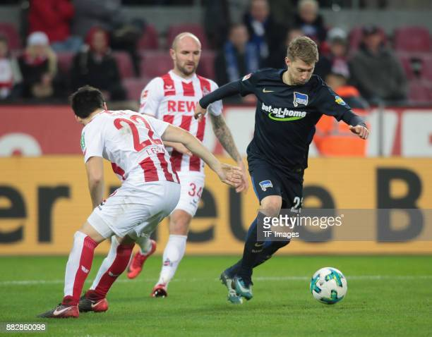 Mitchell Weiser of Hertha BSC Berlin and Jorge Mere of Koeln and Konstantin Rausch battle for the ball during the Bundesliga match between 1 FC Koeln...