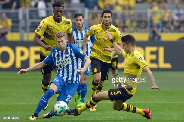 Mitchell Weiser of Hertha BSC Berlin and Marc Bartra of Dortmund battle for the ball during the Bundesliga match between Borussia Dortmund and Hertha...