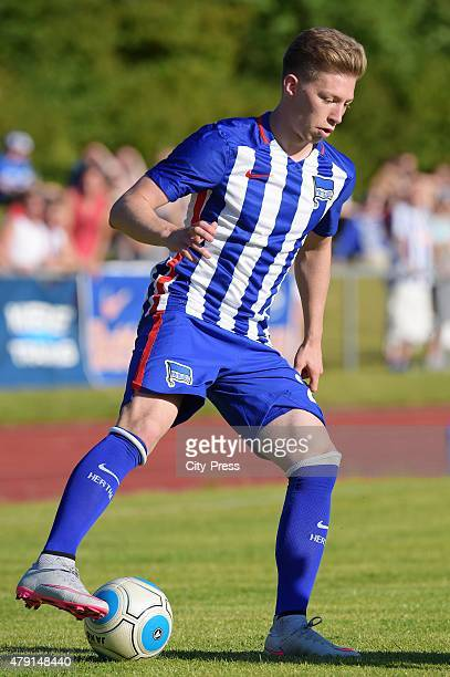 Mitchell Weiser of Hertha BSC handles the ball during the game between dem 1 FC Luebars and Hertha BSC on July 1 2015 in Berlin Germany