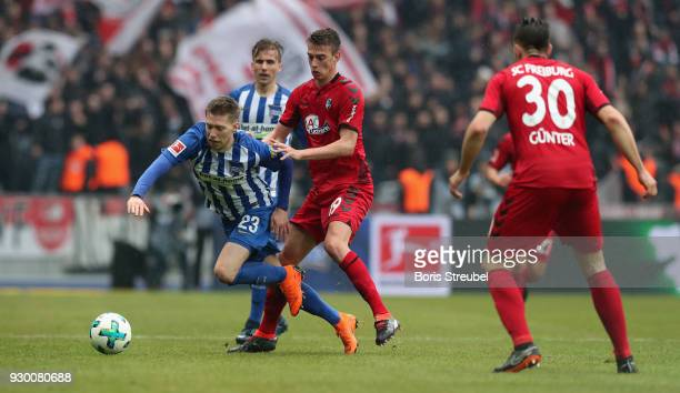 Mitchell Weiser of Hertha BSC is challenged by Janik Haberer of SC Freiburg during the Bundesliga match between Hertha BSC and SportClub Freiburg at...