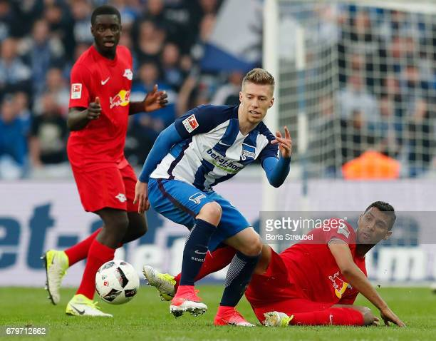 Mitchell Weiser of Hertha BSC is tackled by Marvin Compper of RB Leipzig during the Bundesliga match between Hertha BSC and RB Leipzig at...