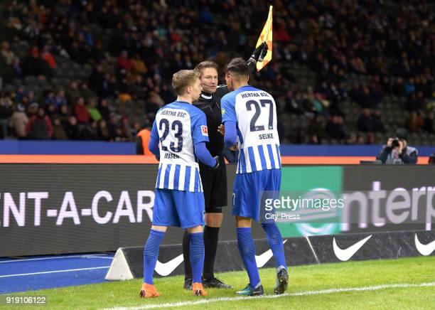 Mitchell Weiser of Hertha BSC linesman Tobias Reichel and Davie Selke of Hertha BSC during the first Bundesliga game between Hertha BSC and 1st FSV...
