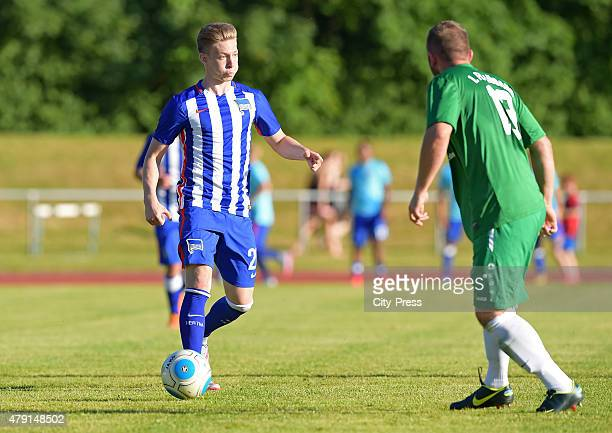 Mitchell Weiser of Hertha BSC passes the ball during the game between dem 1 FC Luebars and Hertha BSC on July 1 2015 in Berlin Germany