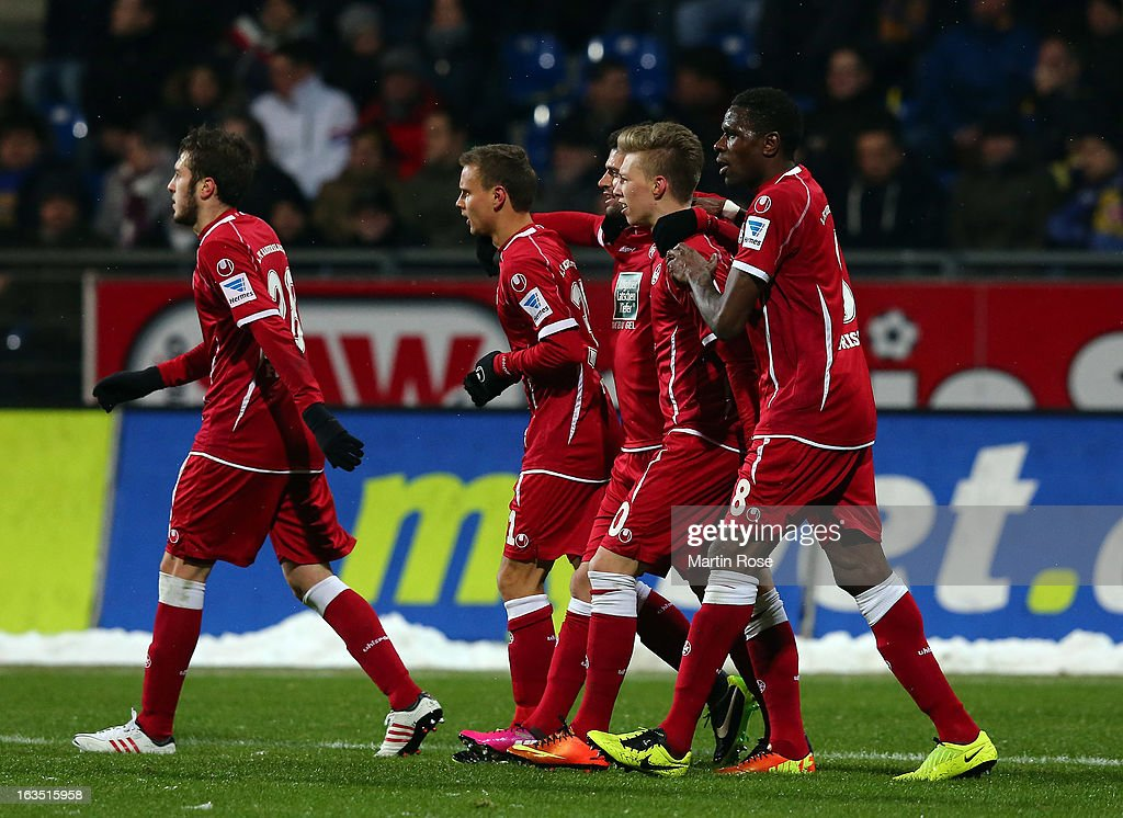 Mitchell Weiser (2nd R) of Kaiserslautern celebrate with his team mates after he scores his team's opening goal during the second Bundesliga match between Eintracht Braunschweig and 1. FC Kaiserslautern at Eintracht Stadium on March 11, 2013 in Braunschweig, Germany.