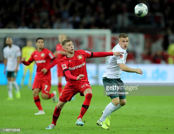 Mitchell Weiser of Leverkusen challenges Maximilian Eggestein of Bremen during the Bundesliga match between Bayer 04 Leverkusen and SV Werder Bremen...