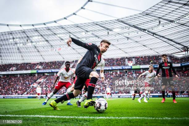 Mitchell Weiser of Leverkusen in action during the Bundesliga match between Bayer 04 Leverkusen and RB Leipzig at BayArena on April 6, 2019 in...