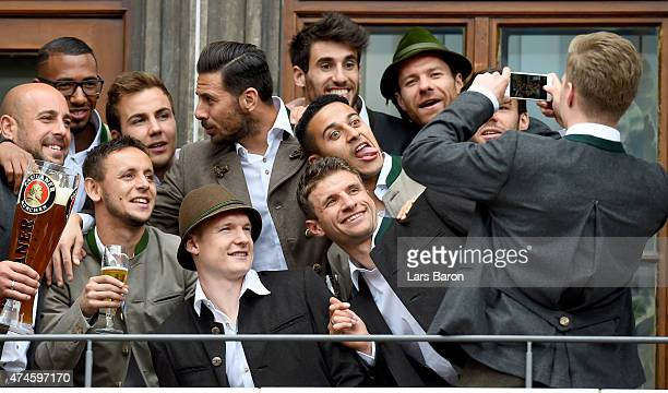 Mitchell Weiser takes a picture during at Marienplatz on May 24 2015 in Munich Germany