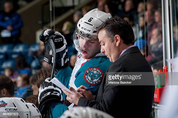 Mitchell Wheaton of the Kelowna Rockets reviews a play with assistant coach Dan Lamert during the first period on January 24 2014 at Prospera Place...