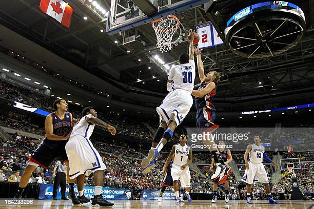 Mitchell Young of the St Mary's Gaels attempts a shot in the first half against DJ Stephens of the Memphis Tigers during the second round of the 2013...